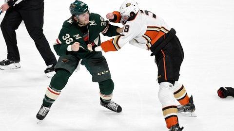 <p>               Minnesota Wild's Ryan Hartman, left, and Anaheim Ducks' Derek Grant fight in the first period of an NHL hockey game, Tuesday, Dec. 10, 2019, in St. Paul, Minn. (AP Photo/Tom Olmscheid)             </p>