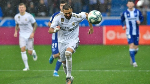 <p>               Real Madrid's Karim Benzema goes for the ball during the Spanish La Liga soccer match between Real Madrid and Alaves at Mendizorroza stadium, in Vitoria, northern Spain, Saturday, Nov. 30, 2019. (AP Photo/Alvaro Barrientos)             </p>