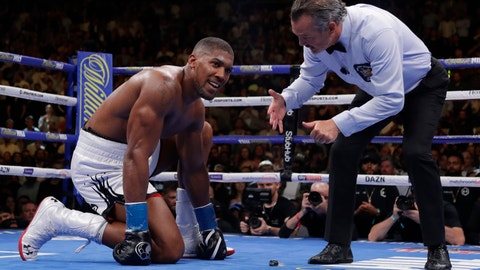 <p>               FILE - In this Saturday, June 1 , 2019 file photo, Britain's Anthony Joshua reacts as the referee counts for him after he was knocked down during the seventh round of a heavyweight title boxing match against Mexican American boxer Andy Ruiz, in New York. Joshua is starting all over as he prepares for his rematch against Andy Ruiz Jr. for the world heavyweight titles. Joshua has had to reinvent himself after losing his IBF, WBA and WBO belts to the Mexican in June in one of boxing's biggest shocks. (AP Photo/Frank Franklin II, File)             </p>