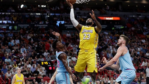 <p>               Los Angeles Lakers forward LeBron James (23) shoots over Miami Heat forward Jimmy Butler (22) and forward Meyers Leonard, right, during the first half of an NBA basketball game, Friday, Dec. 13, 2019, in Miami. (AP Photo/Lynne Sladky)             </p>