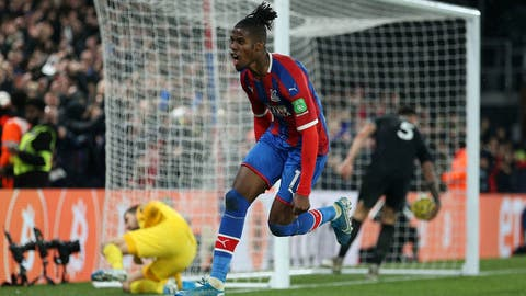 <p>               Crystal Palace's Wilfried Zaha celebrates scoring his side's first goal of the game during their English Premier League soccer match against Brighton & Hove Albion at Selhurst Park, London, Monday, Dec 16, 2019. (Nigel French/PA via AP)             </p>