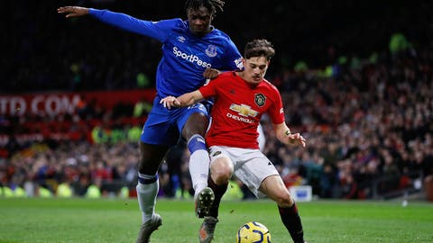 <p>               Everton's Moise Kean, left, and Manchester United's Daniel James battle for the ball during the English Premier League match between Manchester United and Everton at Old Trafford, Manchester, England, Sunday, Dec. 15, 2019. (Martin Rickett/PA via AP)             </p>