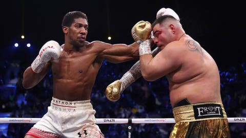 <p>               Defending champion Andy Ruiz Jr., right, during his fight against Britain's Anthony Joshua in their World Heavyweight Championship contest at the Diriyah Arena, Riyadh, Saudi Arabia. (Nick Potts/PA via AP)             </p>
