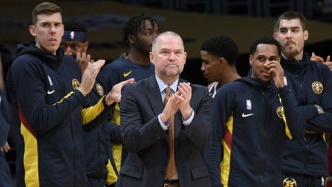 <p>               Denver Nuggets head coach Michael Malone, center, applauds as his team extends their lead against the Los Angeles Lakers during the second half of an NBA basketball game Sunday, Dec. 22, 2019, in Los Angeles. The Nuggets won 128-104. (AP Photo/Michael Owen Baker)             </p>