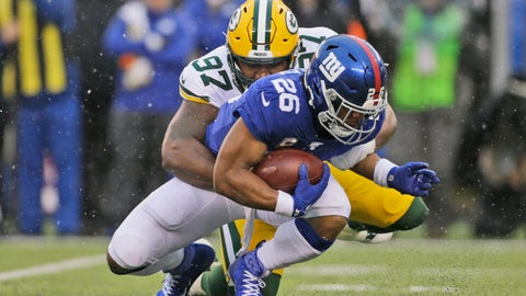 <p>               Green Bay Packers' Kenny Clark, top, tackles New York Giants' Saquon Barkley during the first half of an NFL football game, Sunday, Dec. 1, 2019, in East Rutherford, N.J. (AP Photo/Adam Hunger)             </p>