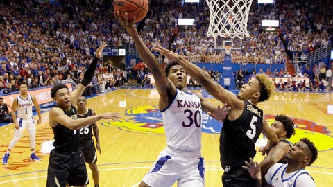 <p>               Kansas' Ochai Agbaji (30) gets past D'Shawn Schwartz (5) to shoot during the first half of an NCAA college basketball game Saturday, Dec. 7, 2019, in Lawrence, Kan. Kansas won 72-58. (AP Photo/Charlie Riedel)             </p>