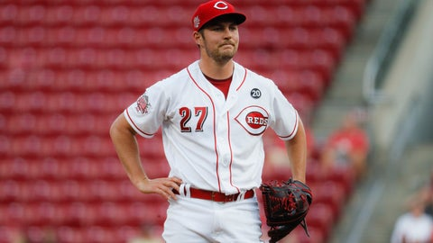 """<p>               FILE - In this Aug. 19, 2019 file photo Cincinnati Reds starting pitcher Trevor Bauer reacts after walking San Diego Padres' Josh Naylor in the first inning of a baseball game in Cincinnati. Bauer sent a series of tweets during the weekend, starting with a jab about Major League Baseball's threat to cut ties with minor league affiliates. Bauer followed up with: """"At least Rob Manfred is trying to ruin baseball at all levels and isn't discriminating."""" MLB had no immediate comment to Bauer's remarks, Sunday, Dec. 15, 2019. Manfred recently said MLB was pushing ahead with a rules change for 2020 that requires pitchers to face at least three batters or finish a half-inning. (AP Photo/John Minchillo)             </p>"""