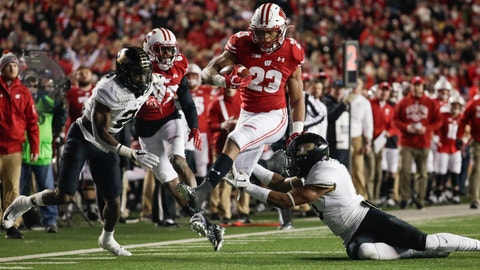 <p>               Wisconsin's Jonathan Taylor runs during the second half of an NCAA college football game against Purdue Saturday, Nov. 23, 2019, in Madison, Wis. (AP Photo/Morry Gash)             </p>