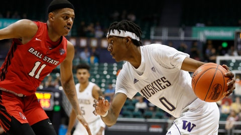 <p>               Washington forward Jayden McDaniels (0) goes toward the basket against Ball State guard Jarron Coleman (11) during the second half of an NCAA college basketball game, Sunday, Dec. 22, 2019, in Honolulu. (AP Photo/Marco Garcia)             </p>