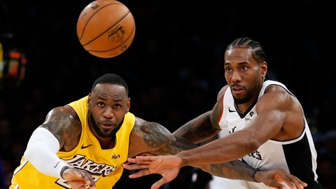 <p>               Los Angeles Lakers' LeBron James, left, and Los Angeles Clippers' Kawhi Leonard (2) chase the ball during the second half of an NBA basketball game Wednesday, Dec. 25, 2019, in Los Angeles. The Clippers won 111-106. (AP Photo/Ringo H.W. Chiu)             </p>