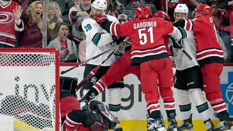<p>               Carolina Hurricanes' Jake Gardiner (51) and Ryan Dzingel (18) tussle with San Jose Sharks' Joe Thornton (19) and Timo Meier (28) of Switzerland after Thornton knocked Carolina goaltender Petr Mrazek (34) of the Czech Republic to the ice during the second period of an NHL hockey game in Raleigh, N.C., Thursday, Dec. 5, 2019. Thornton and Mrazek were penalized on the play. (AP Photo/Chris Seward)             </p>
