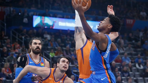 <p>               Oklahoma City Thunder guard Shai Gilgeous-Alexander, right, goes to the basket in front of teammate Steven Adams, left, and Phoenix Suns forward Dario Saric and guard Ricky Rubio during the first half of an NBA basketball game Friday, Dec. 20, 2019, in Oklahoma City. (AP Photo/Sue Ogrocki)             </p>