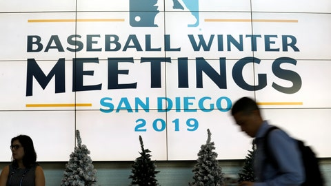 <p>               People pass a display during the Major League Baseball winter meetings Monday, Dec. 9, 2019, in San Diego. (AP Photo/Gregory Bull)             </p>