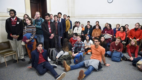 <p>               Students from Yale and Harvard University along with members of the Greater New Haven community charged with disorderly conduct after a protest interrupted the annual Yale Harvard football game, wait in Superior Court in New Haven, Connecticut, for their arraignments on Friday, Dec. 6, 2019.  (Arnold Gold/New Haven Register via AP, Pool)             </p>