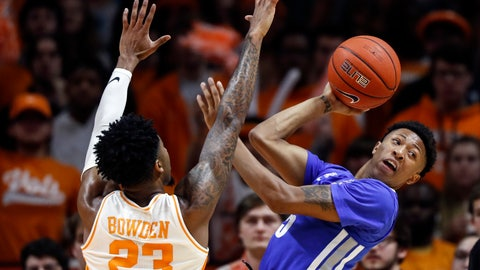 <p>               Memphis guard Boogie Ellis (5) passes the ball off as he's defended by Tennessee guard Jordan Bowden (23) during the first half of an NCAA college basketball game Saturday, Dec. 14, 2019, in Knoxville, Tenn. (AP Photo/Wade Payne)             </p>