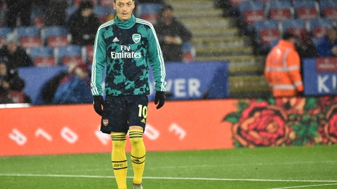 <p>               FILE - In this file photo dated Saturday, Nov. 9, 2019, Arsenal's Mesut Ozil warms up prior to the the English Premier League soccer match against Leicester City at the King Power Stadium in Leicester, England.  Chinese television pulled coverage of Arsenal's Premier League match against Manchester City Sunday Dec. 15, 2019, after Mesut Ozil criticized on social media against Beijing's brutal mass crackdown on ethnic Muslims. (AP Photo/Rui Vieira, FILE)             </p>