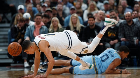 <p>               Denver Nuggets forward Michael Porter Jr., front, loses control of the ball and his footing after colliding with Memphis Grizzlies guard De'Anthony Melton in the first half of an NBA basketball game Saturday, Dec. 28, 2019, in Denver. (AP Photo/David Zalubowski)             </p>