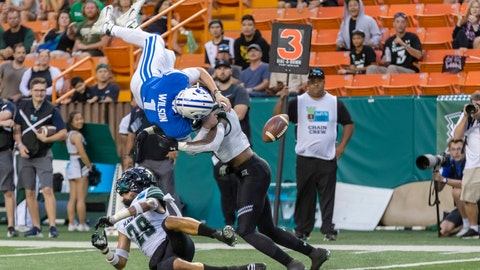 <p>               BYU quarterback Zach Wilson (1) loses the football on a hit by Hawaii defensive back Eugene Ford, right, as Wilson tried to leap into the end zone during the second half of the Hawaii Bowl NCAA college football game Tuesday, Dec. 24, 2019, in Honolulu. Hawaii recovered the football in the end zone for a touchback. (AP Photo/Eugene Tanner)             </p>