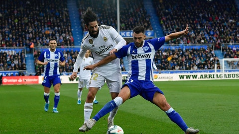 <p>               Real Madrid's Isco, left, duels for the ball with Alaves' Luis Rioja during the Spanish La Liga soccer match between Real Madrid and Alaves at Mendizorroza stadium, in Vitoria, northern Spain, Saturday, Nov. 30, 2019. (AP Photo/Alvaro Barrientos)             </p>