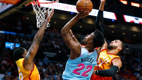 <p>               Miami Heat forward Jimmy Butler (22) goes to the basket between Utah Jazz forward Royce O'Neale (23) and center Rudy Gobert (27) during the first half of an NBA basketball game, Monday, Dec. 23, 2019, in Miami. (AP Photo/Joel Auerbach)             </p>