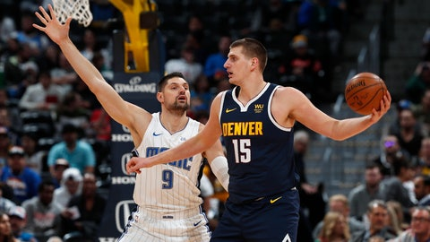 <p>               Denver Nuggets center Nikola Jokic, right, looks to pass the ball as Orlando Magic center Nikola Vucevic defends in the first half of an NBA basketball game Wednesday, Dec. 18, 2019, in Denver. (AP Photo/David Zalubowski)             </p>