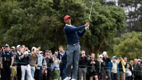 <p>               USA captain Tiger Woods hits an approach shot during a practice session ahead of the President's Cup Golf tournament in Melbourne, Tuesday, Dec. 10, 2019. (AP Photo/Andy Brownbill)             </p>