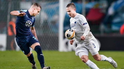 <p>               FC Copenhagen's Pierre Bengtsson, right, and Malmo's Eric Larsson battle for the ball during their Europa League Group B soccer match in Copenhagen, Denmark, Thursday Dec. 12, 2019. (Liselotte Sabroe/Ritzau Scanpix via AP)             </p>