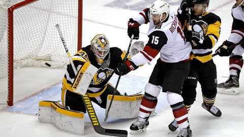 <p>               Pittsburgh Penguins goaltender Tristan Jarry (35) blocks a shot deflected by Arizona Coyotes' Brad Richardson (15) with Penguins' Chad Ruhwedel defending during the first period of an NHL hockey game in Pittsburgh, Friday, Dec. 6, 2019. (AP Photo/Gene J. Puskar)             </p>