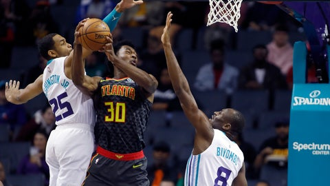 <p>               Atlanta Hawks' Damian Jones (30) tries to score as his shot is rejected by Charlotte Hornets' P.J. Washington (25) and Bismack Biyombo (8) during the first half of an NBA basketball game in Charlotte, N.C., Sunday, Dec. 8, 2019. (AP Photo/Bob Leverone)             </p>