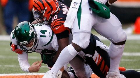 <p>               New York Jets quarterback Sam Darnold (14) is sacked by Cincinnati Bengals defensive end Carlos Dunlap (96) during the second half of an NFL football game, Sunday, Dec. 1, 2019, in Cincinnati. (AP Photo/Gary Landers)             </p>