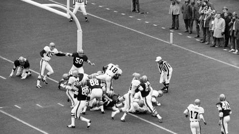 <p>               FILE - In this Nov. 15, 1970, file photo, Cincinnati Bengals' Paul Robinson (18) scores the game-winning touchdown from the one-yard-line in the first half of a football game against the Cleveland Browns in Cincinnati. Others shown are Bengals' Jess Phillips (30) and Browns' Joe Jones (80), Jim Houston (82), Ron Snidow (88), Walter Johnson (71) and John Garlington (50). The Cincinnati Bengals' 14-10 victory over the Cleveland Browns on a snowy, November afternoon in 1970 put Brown's new team on equal footing with his old one and made Ohio truly a two-team pro football state. (AP Photo/GS, File)             </p>