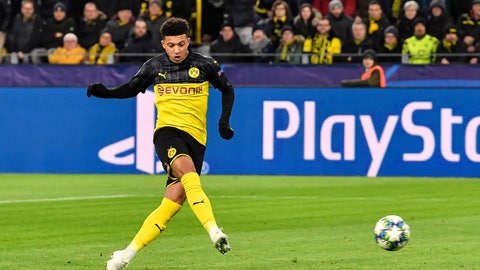 <p>               Dortmund's Jadon Sancho scores the opening goal during the Champions League Group F soccer match between Borussia Dortmund and Slavia Praha in Dortmund, Germany, Tuesday, Dec. 10, 2019. (AP Photo/Martin Meissner)             </p>