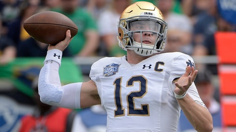<p>               Notre Dame quarterback Ian Book (12) throws a pass during the first half of the Camping World Bowl NCAA college football game against Iowa State Saturday, Dec. 28, 2019, in Orlando, Fla. (AP Photo/Phelan M. Ebenhack)             </p>