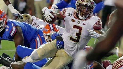 <p>               Florida State running back Cam Akers (3) runs for a first down against Florida on fourth=and-1 during the first half of an NCAA college football game, Saturday, Nov. 30, 2019, in Gainesville, Fla. (AP Photo/John Raoux)             </p>