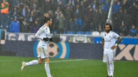 <p>               Real Madrid's Gareth Bale, left, leaves the pitch as Marcelo looks on during the Spanish La Liga soccer match between Real Madrid and Alaves at Mendizorroza stadium, in Vitoria, northern Spain, Saturday, Nov. 30, 2019. (AP Photo/Alvaro Barrientos)             </p>