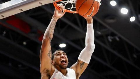 <p>               Dayton's Obi Toppin dunks during the first half of an NCAA college basketball game against Houston Baptist, Tuesday, Dec. 3, 2019, in Dayton, Ohio. (AP Photo/John Minchillo)             </p>