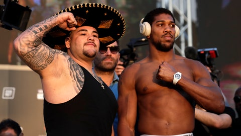"<p>               Heavyweight boxers Anthony Joshua of Britain, right, and Andy Ruiz Jr. of Mexico pose during a weigh-in at Faisaliah Center, in Riyadh, Saudi Arabia, Friday, Dec. 6, 2019. The first ever heavyweight title fight in the Middle East, has been called the ""Clash on the Dunes."" Will take place at the Diriyah Arena on Saturday. (AP Photo/Hassan Ammar)             </p>"