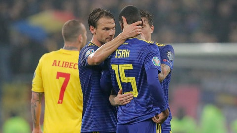 <p>               Team mates hug Sweden's Alexander Isak after referee Daniele Orsato briefly stopped the game following alleged racist chants against the player during the Euro 2020 group F qualifying soccer match between Romania and Sweden on the National Arena stadium in Bucharest, Romania, Friday, Nov. 15, 2019. (AP Photo/Vadim Ghirda)             </p>