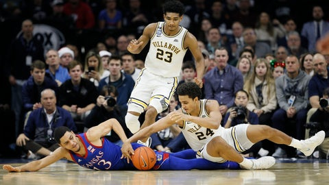 <p>               Kansas' Tristan Enaruna (13) vies for a loose ball with Villanova's Jeremiah Robinson-Earl (24) as Villanova's Jermaine Samuels (23) looks on during the second half of an NCAA college basketball game, Saturday, Dec. 21, 2019, in Philadelphia. (AP Photo/Matt Slocum)             </p>