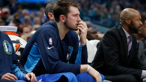 <p>               Dallas Mavericks forward Luka Doncic (77) watches play in the first half of an NBA basketball game against the Los Angeles Clippers in Dallas, Tuesday, Nov. 26, 2019. (AP Photo/Tony Gutierrez)             </p>