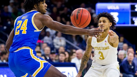 <p>               Notre Dame's Prentiss Hubb (3) passes around UCLA's Jalen Hill (24) during the first half of an NCAA college basketball game Saturday, Dec. 14, 2019, in South Bend, Ind. (AP Photo/Robert Franklin)             </p>