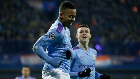 <p>               Manchester City's Gabriel Jesus, front, celebrates with Manchester City's Phil Foden after scoring his side's second goal during the Champions League group C soccer match between Dinamo Zagreb and Manchester City at Maksimir Stadium in Zagreb, Croatia, Wednesday, Dec. 11, 2019. (AP Photo/Darko Bandic)             </p>
