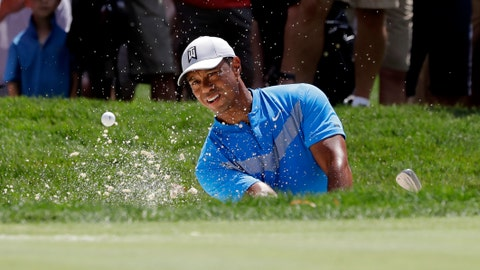 <p>               FILE - In this Thursday, Aug. 15, 2019 file photo, Tiger Woods hits from a sand trap on the fourth hole during the first round of the BMW Championship golf tournament at Medinah Country Club in Medinah, Ill. Woods is in the Bahamas this week as a player and a host, and in Australia next week as a player and Presidents Cup captain. (AP Photo/Nam Y. Huh, File)             </p>
