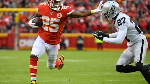 <p>               FILE - In this Sunday, Dec. 1, 2019 file photo, Kansas City Chiefs running back LeSean McCoy (25) fends off Oakland Raiders cornerback Trayvon Mullen (27) during the first half of an NFL football game in Kansas City, Mo.  Kansas City Chiefs running back LeSean McCoy and his former girlfriend have reached a settlement in a lawsuit she filed against him, court records show, Wednesday, Dec. 4, 2019. Delicia Cordon filed the lawsuit last year accusing McCoy of failing to protect her from a violent July 2018 home invasion at a home he owns in Milton, just outside Atlanta. (AP Photo/Reed Hoffmann, File)             </p>