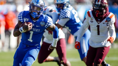 <p>               Kentucky quarterback Lynn Bowden Jr. (1) breaks free for a 25-yard touchdown run against Virginia Tech in the first half of the Belk Bowl NCAA college football game in Charlotte, N.C., Tuesday, Dec. 31, 2019. (AP Photo/Nell Redmond)             </p>