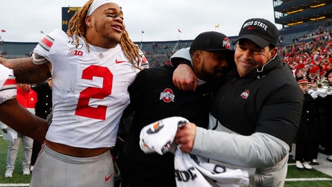 <p>               Ohio State defensive end Chase Young (2), linebackers coach Al Washington and head coach Ryan Day celebrate after a 56-27 win against Michigan after an NCAA college football game in Ann Arbor, Mich., Saturday, Nov. 30, 2019. (AP Photo/Paul Sancya)             </p>