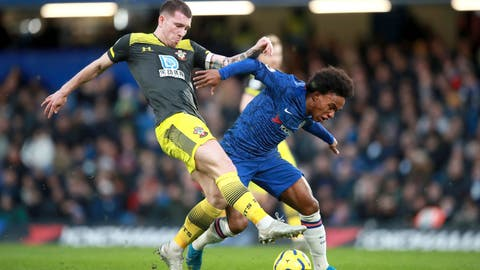 <p>               Southampton's Pierre-Emile Hojbjerg, left, and Chelsea's Willian battle for the ball during their English Premier League soccer match at Stamford Bridge, London, Thursday, Dec. 26, 2019. (Adam Davy/PA via AP)             </p>