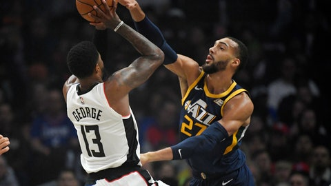 <p>               Los Angeles Clippers forward Paul George, left, shoots as Utah Jazz center Rudy Gobert defends during the first half of an NBA basketball game Saturday, Dec. 28, 2019, in Los Angeles. (AP Photo/Mark J. Terrill)             </p>