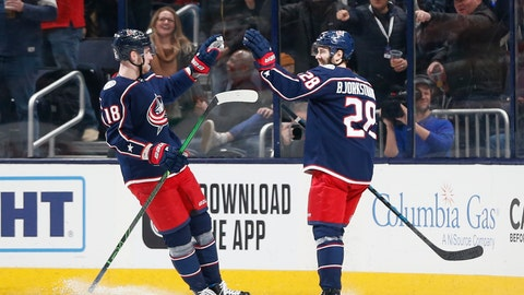 <p>               Columbus Blue Jackets' Oliver Bjorkstrand, right, of Denmark, celebrates his goal against the New Jersey Devils with teammate Pierre-Luc Dubois during the first period of an NHL hockey game Saturday, Dec. 21, 2019, in Columbus, Ohio. (AP Photo/Jay LaPrete)             </p>