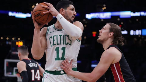 <p>               Boston Celtics center Enes Kanter (11) looks to pass as he is covered by Miami Heat forward Kelly Olynyk, right, during the first half of an NBA basketball game in Boston, Wednesday, Dec. 4, 2019. (AP Photo/Charles Krupa)             </p>
